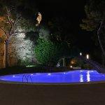 Pool and Moorish tower at night