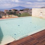 Rooftop pool with view of Mt Vesuvius