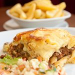 Homemade Pastitsio, macaroni cheese & beef mincemeat covered with a cream cheese topping