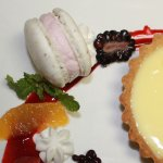 Lemon tart, lavender almond crust, lemon curd, berries, pink peppercorn macaron.