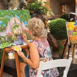 Elaine Morgan from Eclectic Image Gallery painting in the courtyards of Tlaquepaque