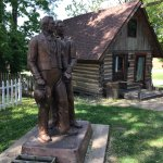 statue and cabin in historical village