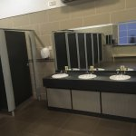 Grounds and spotless ladies shower room.