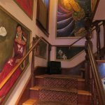 stair case with art (dining upstairs on both a deck and private dining room(s)