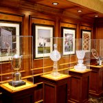 Golf trophies on display in hall outside the restaurant.