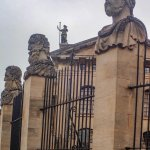 Portrait heads on the fence surrounding the Bodleian Library courtyard