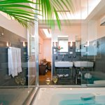 Jacuzzi tub & double sinks in our Suites & Deluxe Suites