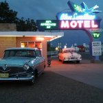 Neon Sign and Classic cars at Sunset