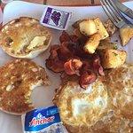 yummy breakfast:eggs over hard (I like them well done), crispy bacon (piece missing), potatoes,