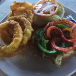 Just okay mahi fish sandwich with lettuce & tomato. Great onion rings though.