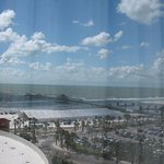 Taken from window inside room. View of Pier and beach.