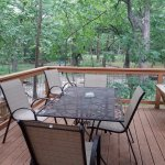 Fenced outdoor deck overlooking the creek