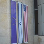 The Palestinian, Israeli, and U.S. flags were on the exterior of the hotel