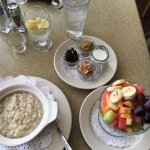 Bob's Red Mill Oatmeal (w/raisins, almonds, brown sugar & cream) + seasonal fresh fruit!