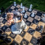 Captivating picture of our newly-weds dancing among the life-sized chess pieces.