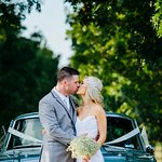 A newly married couple share a kiss in the Preston Peak driveway.