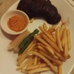 Ostrich steak with french fries at Swiss deli