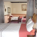 cosy family room ,called the african room queen and two single beds ,curtain dividing the room t