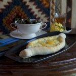 Traditional Georgian cuisine -Khachapuri AJARULI