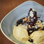 Brownie with vanilla ice cream and almonds