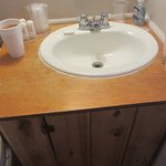 Sink top is made of wood. Wood not good for sanitation purposes