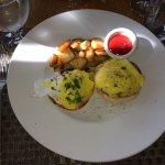 Eggs Benedict and hash brown potatoes