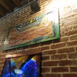 my favorite bacon painting on the exposed brick @ belmont