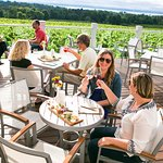 Stay for a while on the Upper Deck overlooking the vineyard and East Bay