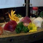 Sashimi - salmon, tuna, yellowtail, escolar, octopus, quail egg shot.
