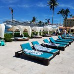 Very nice cababas, lounge chairs by pool and on beach. Clean bathrooms and changing area.