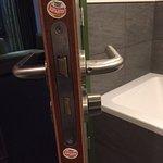 fruit stickers on bathroom door