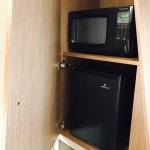 Refrigerator and Microwave hidden in wall cabinet