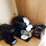 Coffee maker with coffee selections, ice bucket and drinking glasses