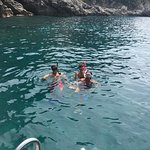 snorkling in the bright blue water and by caves!