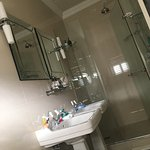 Pristine double sinks bathroom with a rocking shower & great amenities