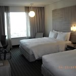 Comfortable two Queen Size beds and room furnished with modern furniture and furnishings
