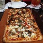 Ai Funghi E Salsiccia flatbread with Italian sausage, mushrooms, tomatoes and Mozzarella cheese