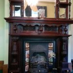 One of two magnificently carved wooden fireplaces (in dining rooms)
