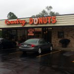 parking lot & entrance to Country Donuts