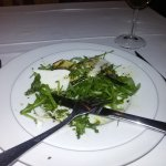 Starter with cheese, courgettes served on rocket salad