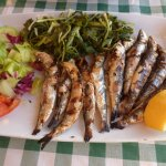 grilled sardines with Cretan greens