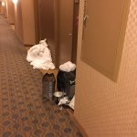Garbage and dirty linen down the hall from my room after maid service ended for the evening