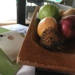 Chipped fruit bowl, old wilted fruits, bot even a plat & knife for chopping