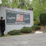Louis standing in front of  a memorial.