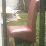 discarded chair and debris outside bedroom