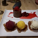 Delicious! My goat's cheese tart and shared puds. Blackcurrant sorbet, mango sorbet and vanilla