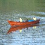 Activities include boating on Lake Bunyonyi