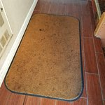 And after you go through the door, get a load of this clean rug, and look at the venting unit