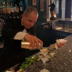 Claudio making incredible Dirty Martinis
