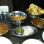dishes, naan and one other bread and a starter